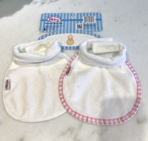 Two different colors of Bibby bibs - the patented baby bib with a collar