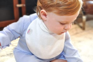 baby looking down wearing a Bibby collared bib